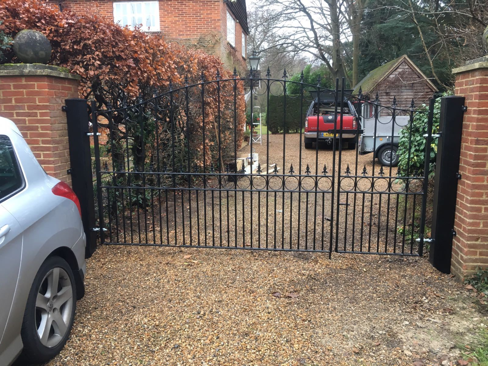 Royal Talisman wrought iron driveway gates fitted to brick pillars